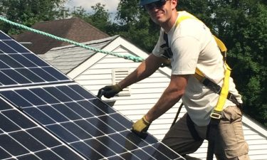 a man working on a solar panel