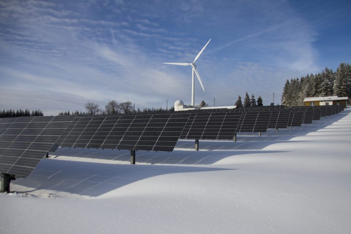 solar panels and a wind turbine in a snowy setting in Pennsylvania