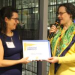 PA Solar Center Director Sharon Pillar presenting Angela Garcia, Executive Director of Global Links, with the Lodestar Award